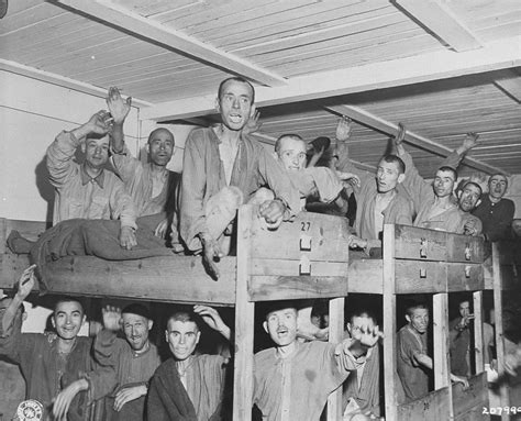Survivors wave to American liberators from their bunks in